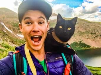 Cat on shoulders of dad