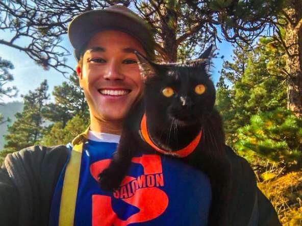 Cat on shoulders of man
