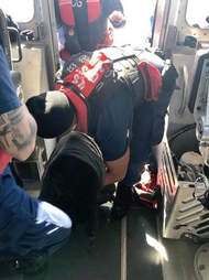 coast guard puts blanket on dog