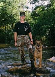 Christopher Baity and his dog in the Marine Corps