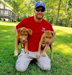 Christopher Baity with two service dogs