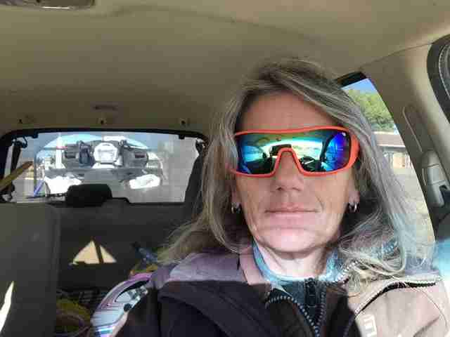 A woman in sunglasses, driving down the highway in Canada
