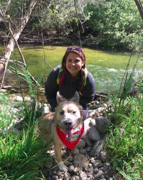Woman and dog hiking together