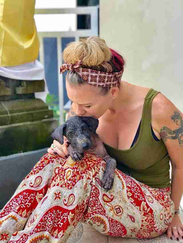 Woman kissing rescued dog in Bali, Indonesia