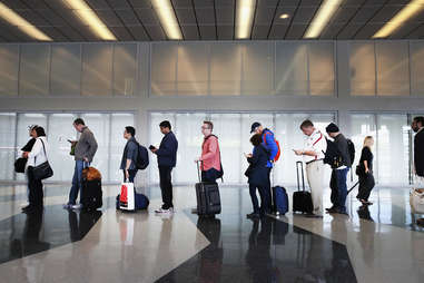 People in airport Line