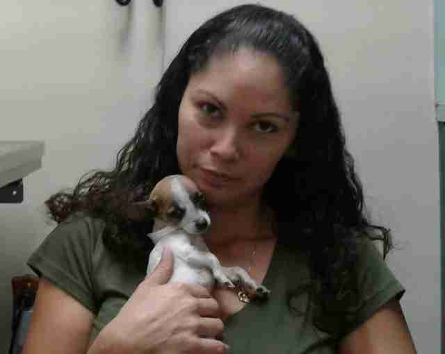 Woman holding rescued puppy to her