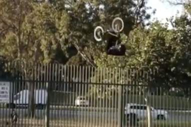 fence bike trick