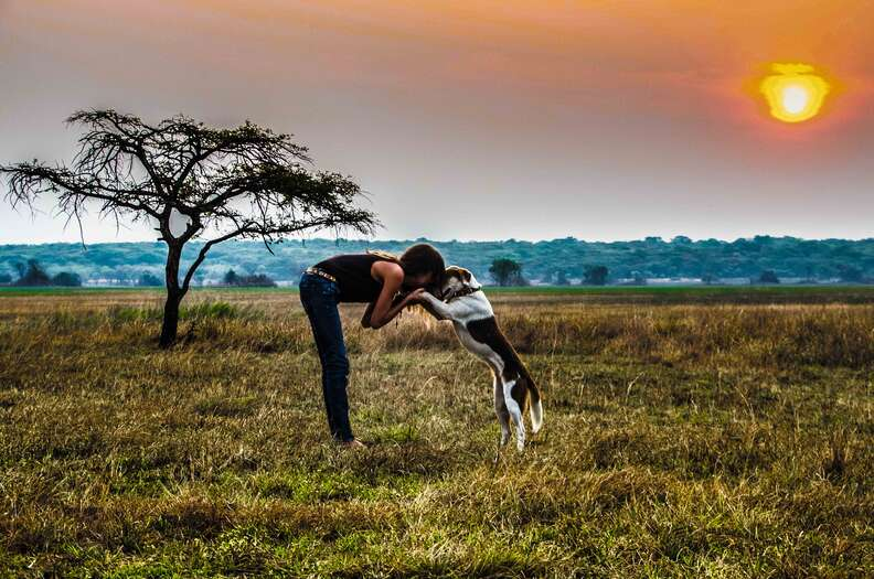 Woman with dog in Africa
