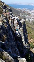 Climbers descending cliff in South Africa