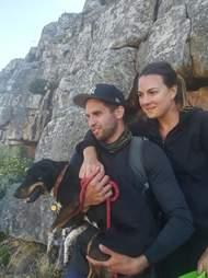 Couple holding dog