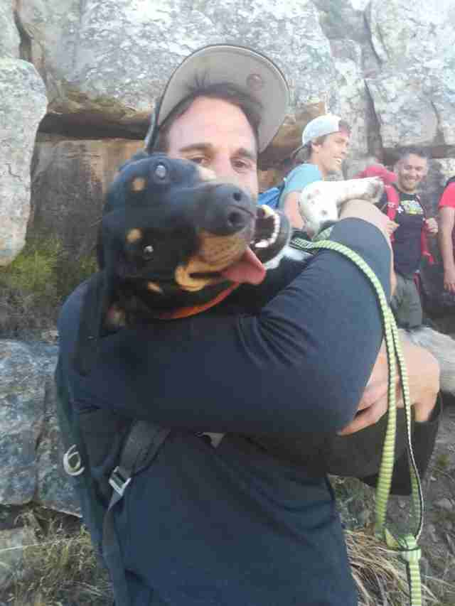 Holly being held by man after being rescue