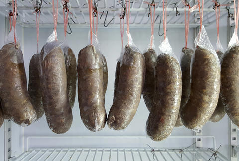 sausage hanging in freezer