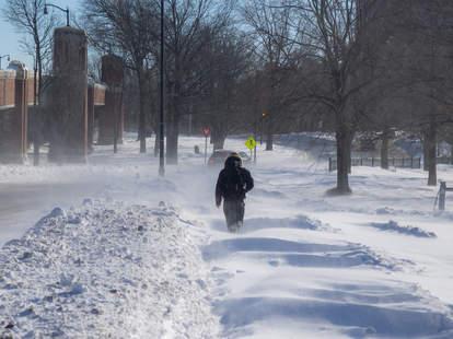 person walking through snow