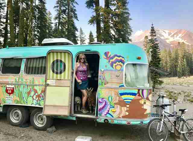 Pet goat and dog go on adventures in vintage Airstream