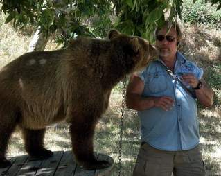 Notorious animal trainer with a captive bear