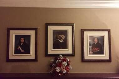 Yogi's graduation picture hangs over mantelpiece