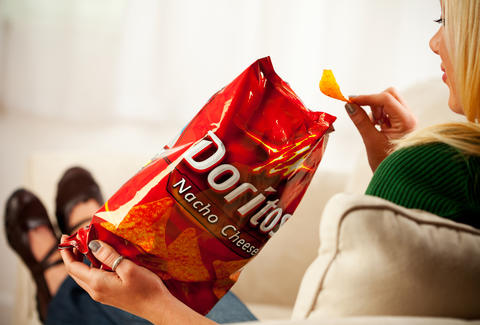 woman eating doritos