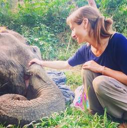 Sanctuary founder comforting elephant