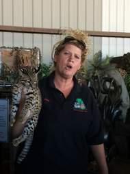 Woman holding big cat at roadside zoo