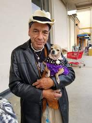Homeless man holding dog