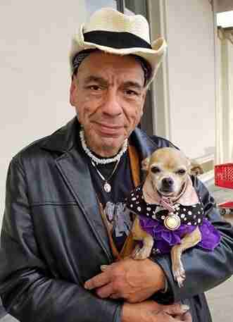Homeless man holding chihuahua