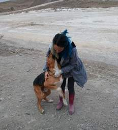 Woman hugging stray dog
