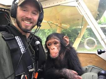 Pilot holding baby chimp
