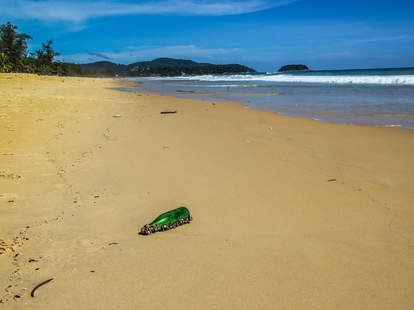 glass bottle on beach