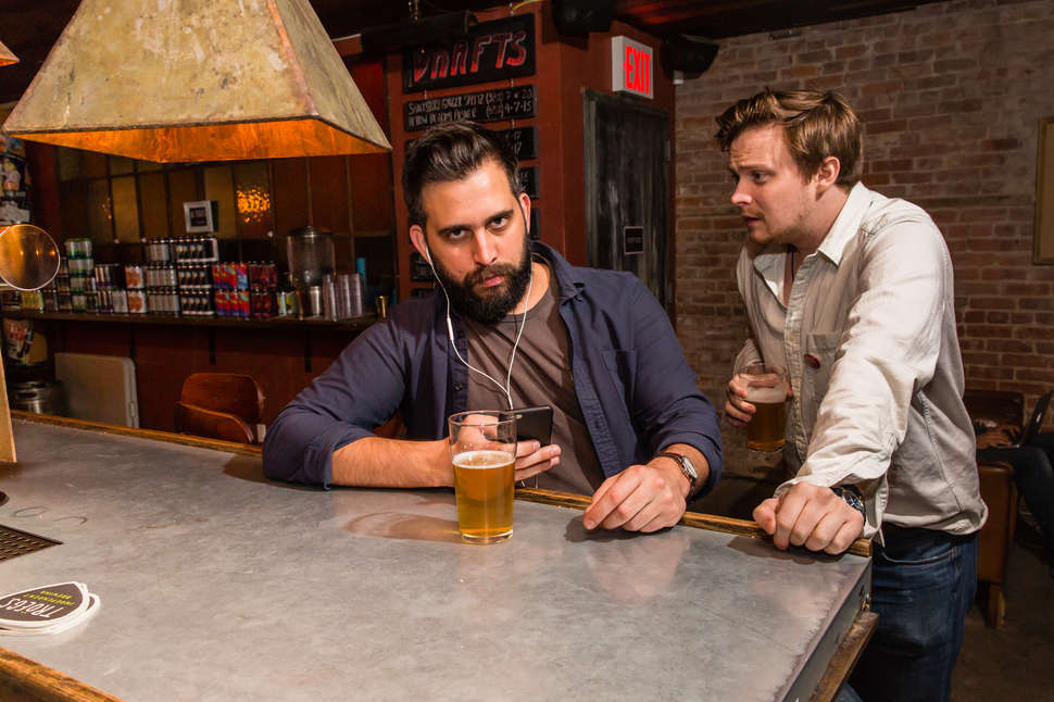 A guide to drinking alone at a bar thrillist two people in a bar ccuart Choice Image