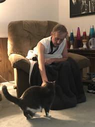 Man petting cat