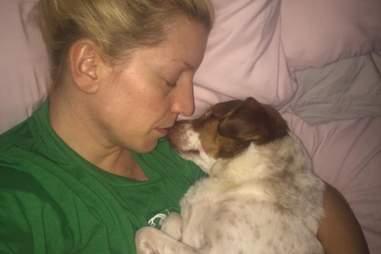 Jami snuggles her rescue dog George