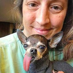 Woman snuggling with dog