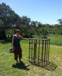Woman looking at cage that imprisoned chimp