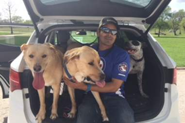JoJo the rescue dog with her foster family