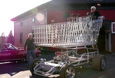 Watch Guy Fieri Drive Jay Leno Around in a Giant, 300-Horsepower Shopping Cart