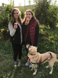 Michele and Danielle Sykora and service dog Thai