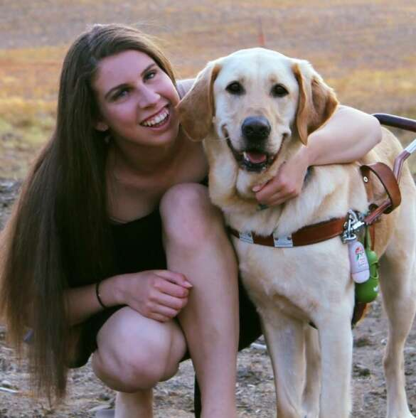 Danielle Sykora and her seeing eye dog Thai