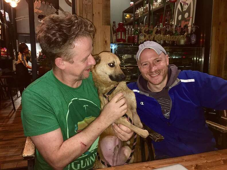 Two men with dog at pub