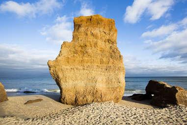 a giant stone on a beach