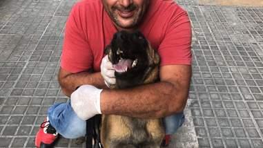 Man hugging Malinois dog
