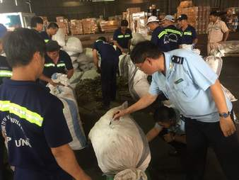 Customs officials with seizure of pangolin scales