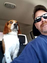Gregory in the car with rescuer Joe