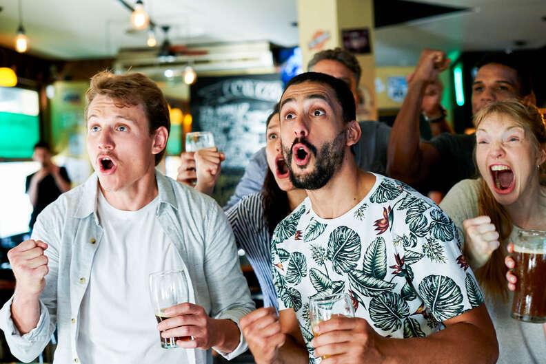 cheering at a bar