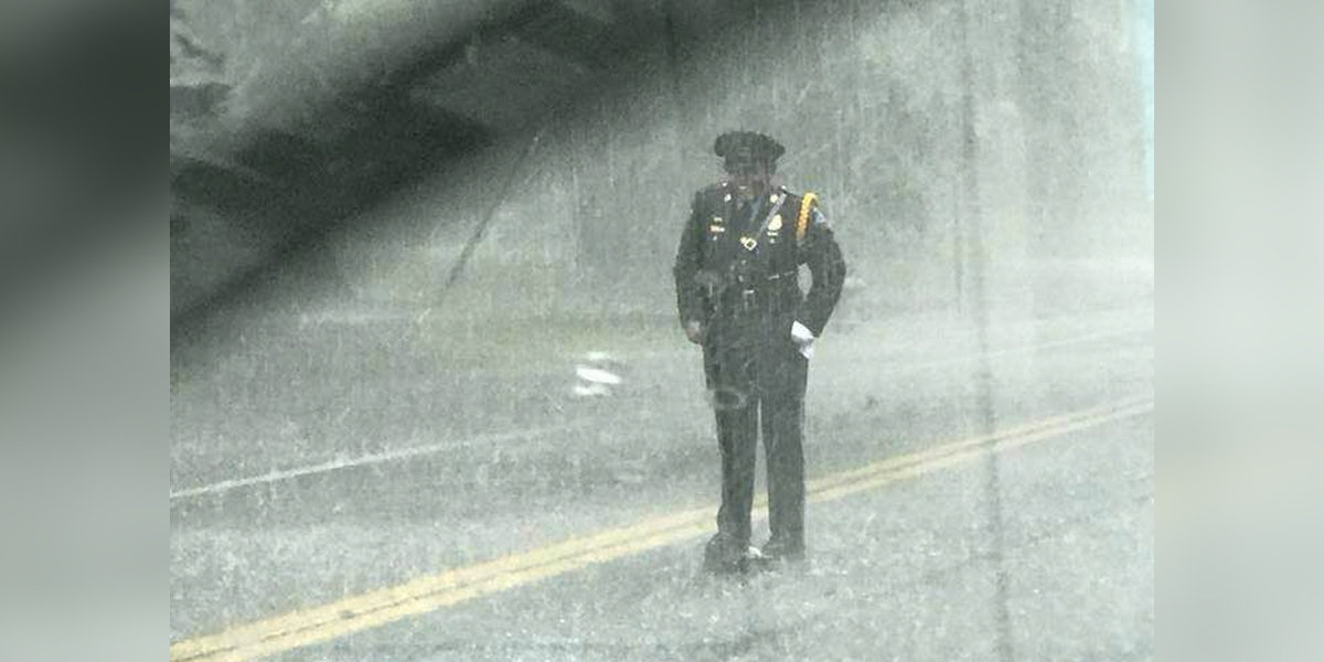 Couple Sees Cop Standing In Pouring Rain — Then Realizes She's Saving A Life