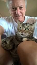 Man holding cat on his lap