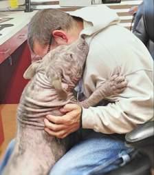 Sylvia hugs a rescue worker