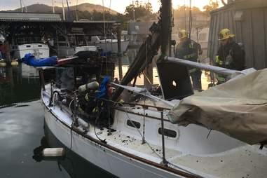 A charred sailboat in the San Rafael Yacht Harbor
