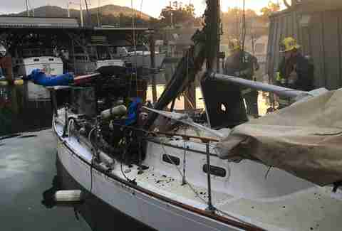 A charred sailboat in the San Rafael Yacht Harbor