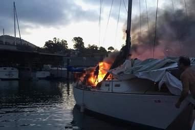 A burning boat at a California marina