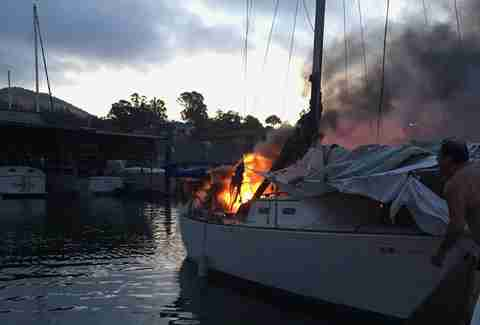 A burning boat at a California marina